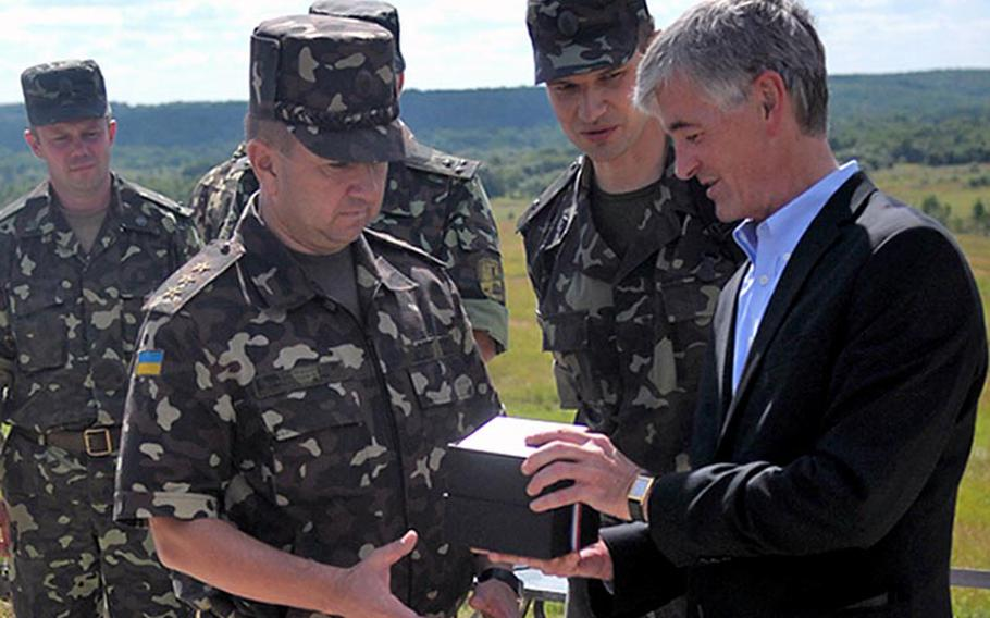 Secretary of the Army John McHugh tours Rapid Trident 2011 in Ukraine. Rapid Trident 2011 is a multi-national airborne operation and field training exercise in support of Ukraine?s Annual Program to achieve interoperability with NATO.