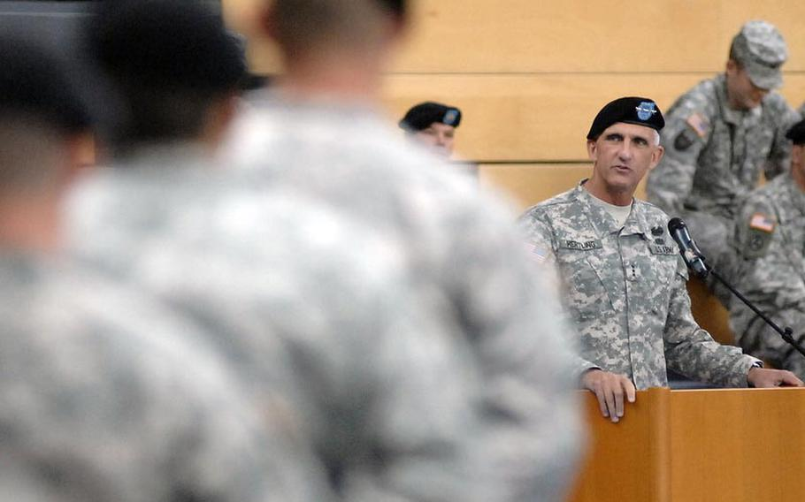 Lt. Gen. Mark Hertling, U.S. Army Europe commander, speaks to the soldiers of V Corps at a  ceremony Friday marking the move of the corps from Heidelberg, Germany, to Wiesbaden. Hertling compared the corps to a phoenix rising from the dust, as a scheduled  inactivation of the unit in 2009 was postponed, then canceled.