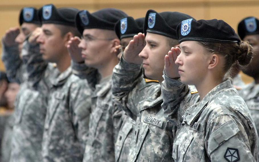 V Corps soldiers salute during the rendering of honors at  a ceremony Friday marking the move of the corps from Heidelberg, Germany, to Wiesbaden. A scheduled  inactivation of the unit in 2009 was postponed, then canceled, as V Corps remains the only permanently forward deployed corps in the Army.