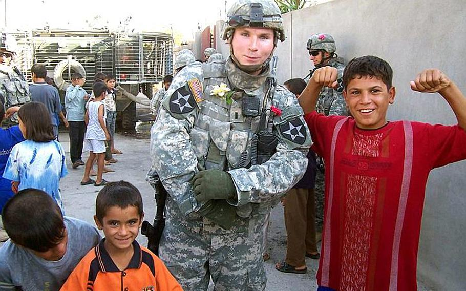 Then-Army 1st Lt. Blake Hall poses with Iraqi children in Mosul in October 2006. After leaving the military and graduating from Harvard Business School, Hall cofounded Troopswap, a Washington-based company that offers daily deals to members of the military community.