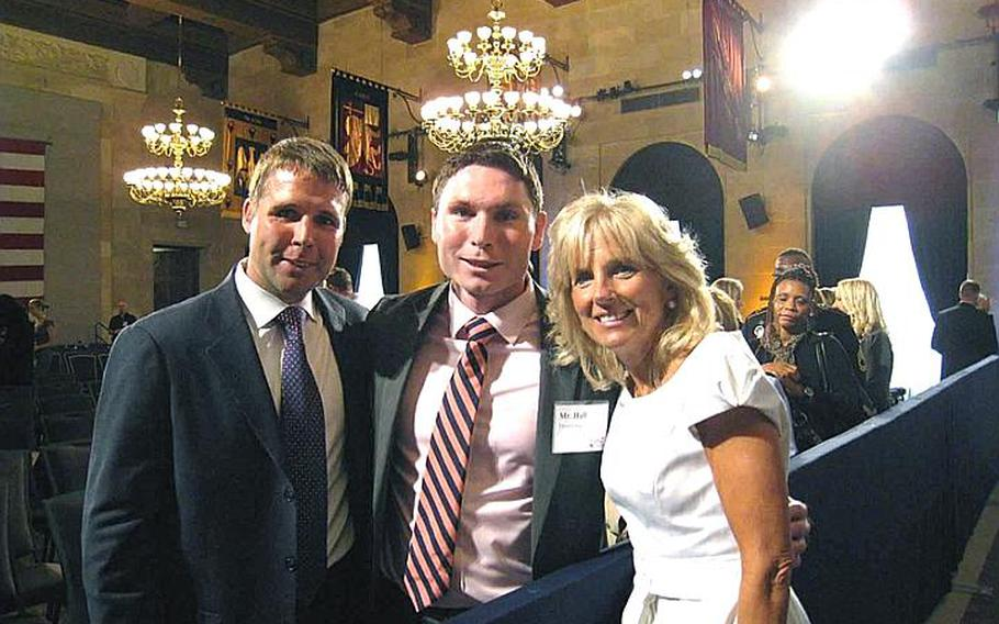 Matthew Thompson, left, and Blake Hall, Army veterans and founders of Troopswap, pose with second lady Jill Biden at a June 29 event at the U.S. Chamber of Commerce in Washington.