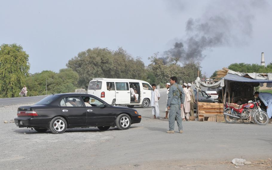 Smoke from a burning fuel tanker rises above Highway 7 in eastern Nangarhar province last week. An ongoing dispute between rival tribes led to an attack on the tanker and caused Afghan security forces to close the road.