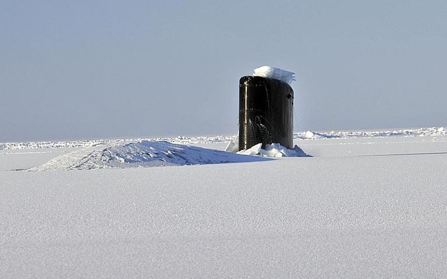 The Los Angeles-class submarine USS Annapolis (SSN 760) breaks through three feet of ice while participating in Ice Exercise (ICEX 2009) in the Arctic Ocean.