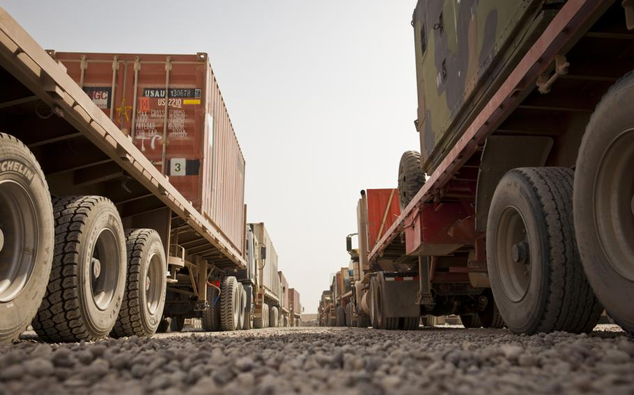 Dozens of armored cargo trucks prepare to unload and load cargo at the largest U.S. Army Central Shipping and Receiving Point yard in Iraq at Sather Air Base outside Baghdad on August 18. More than 1,200 units of goods are currently at the yard while 300-500 units arrive and are shipped out each day. These trucks will be loaded with goods brought to Sather from bases that are drawing down and closing and driven to Contingency Operating Base Adder, an enduring U.S. base in Tallil, Iraq.