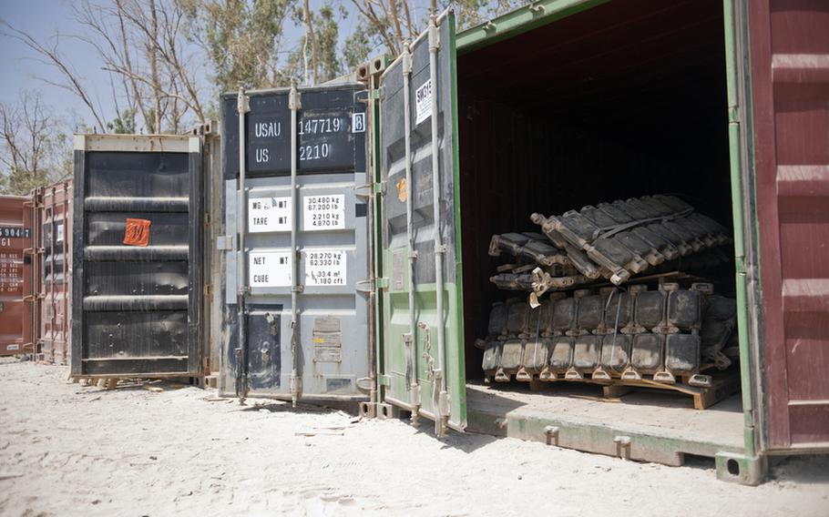 Tank tracks, weapons, tires and other used materials are separated into containers at Sather Air Base outside Baghdad, Iraq, that will be transferred to a different unit in need of the item, be shipped back to the United States, given to Iraq or be disposed of as part of the drawdown of U.S. forces in Iraq.