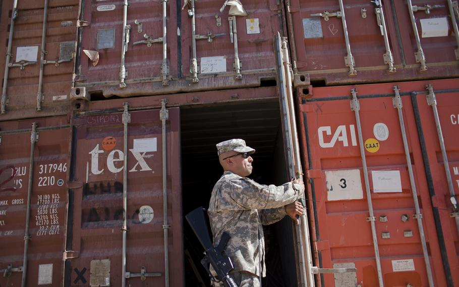 Sgt. 1st Class William Rivera Jr., a supply sergeant at Forward Operating Base Union III in Baghdad's International Zone, inspects containers full of supplies that are to be repurposed as part of the U.S. drawdown in Iraq.