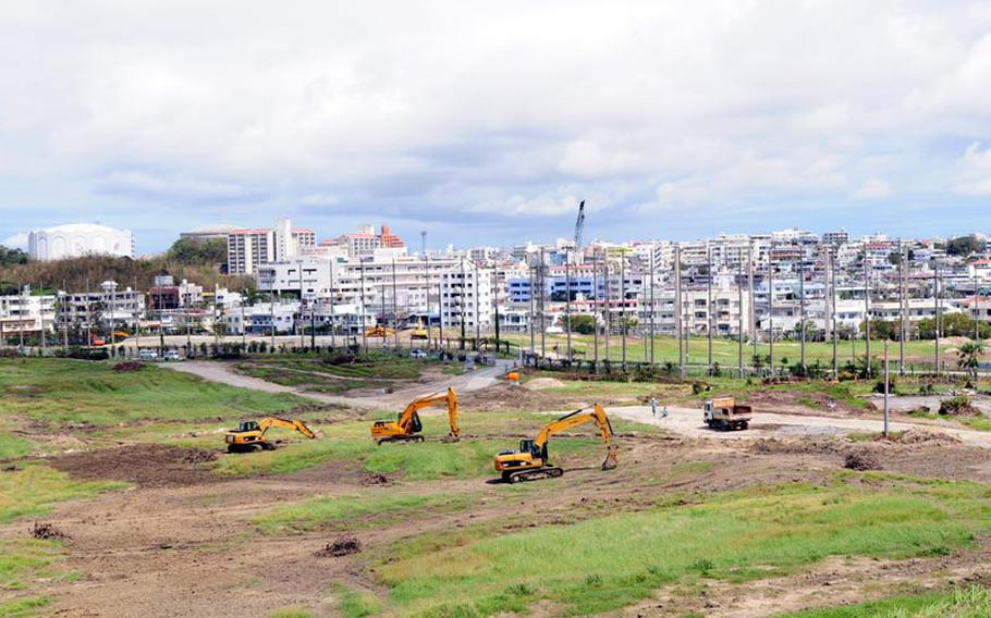 Earth-moving equipment clears the former Awase golf course, which was once a military-owned recreation spot for U.S. servicemembers in central Okinawa until it was returned to the island last year. Now, plans call for it to be redeveloped into a mall, hospital, hotel and residental area. Okinawa hopes the site will be as successful as two other major commercial complexes built on the site of former military land.