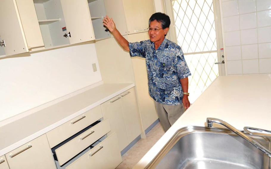 Property manager and developer Seijun Tokuzato shows off the Mediterranean-style homes he has built to rent to U.S. personnel on Okinawa. Many Okinawans invest in such housing, which is considered as solid an investment as stocks or retirement funds, Tokuzato said.