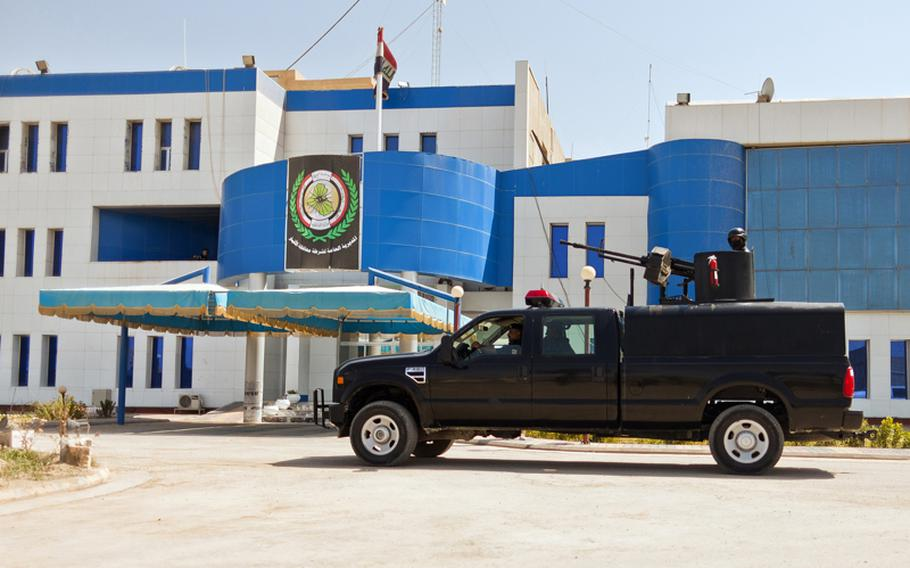 An armed Iraqi police vehicle enters the Police Headquarters in Ramadi, Iraq on Aug. 13.
