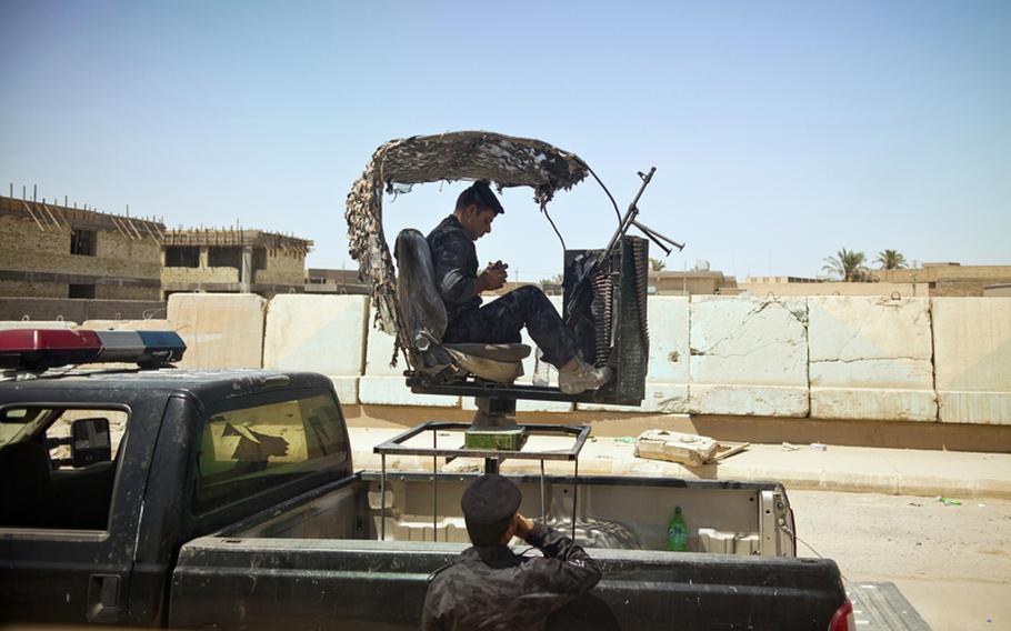 Iraqi police guard the entrance to Police Headquarters on Aug. 13 in Ramadi, Iraq.