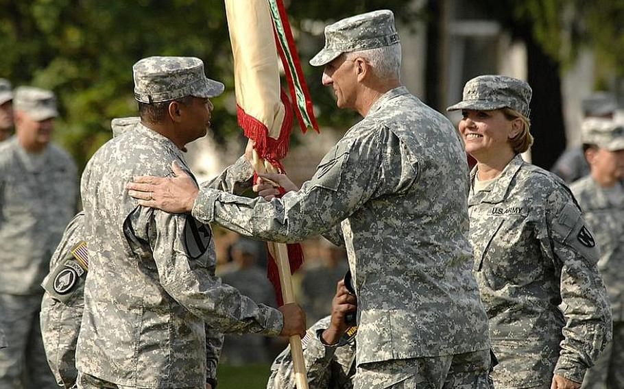 Brig. Gen. Aundre Piggee, left, takes the colors of the 21st Theater Sustainment Command from USAREUR commander Lt. Gen. Mark Hertling, as outgoing 21st TSC commander Maj. Gen.Patricia McQuistion watches, at a ceremony at Daenner Kaserne in Kaiserslautern, Germany, on Thursday.