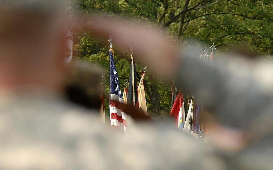 Soldiers salute during the national anthem at the 21st Theater Sustainment Command's change of command ceremony at Daenner Kaserne in Kaiserslautern, Germany, on Thursday. Brig. Gen. Aundre Piggee took over the reins of the 21st TSC from Maj. Gen.Patricia McQuistion, who is to be the commanding general of the U.S. Army Sustainment Command in Rock Island, Ill.