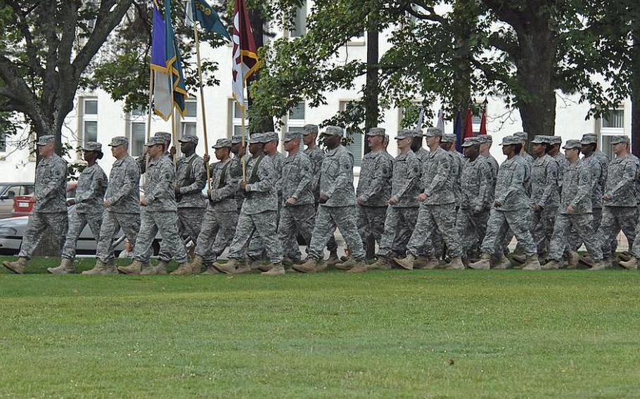 Soldiers of the 21st Theater Sustainment Command march on to the Daenner Kaserne parade field in Kaiserslautern, Germany, for the 21st TSC's change of command ceremony, on Thursday. Brig. Gen. Aundre Piggee took command from Maj. Gen. Patricia McQuistion, who is to be the commanding general of the U.S. Army Sustainment Command in Rock Island, Ill.