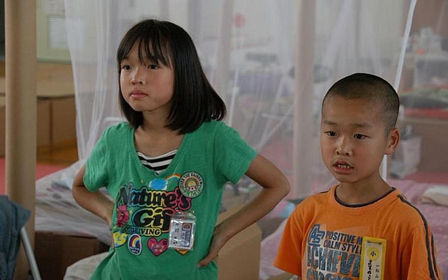 These students are still living with their family in Watanoha Elementary School, five-and-a-half months after their home was destroyed by a massive tsunami.
