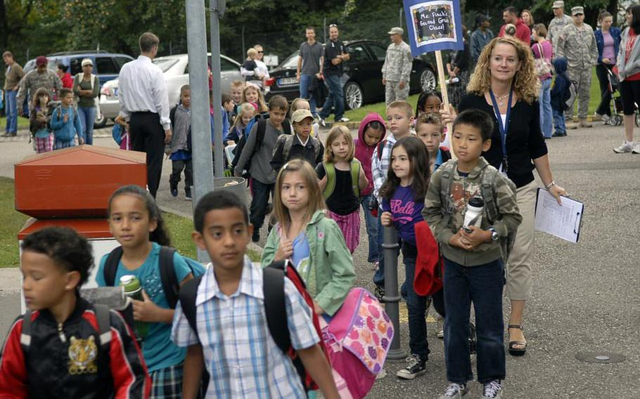 Parents watch as teachers at Robinson Elementary/Middle School lead their students to the classrooms on the first day of school Aug. 29 at Robinson Barracks in Stuttgart, Germany.