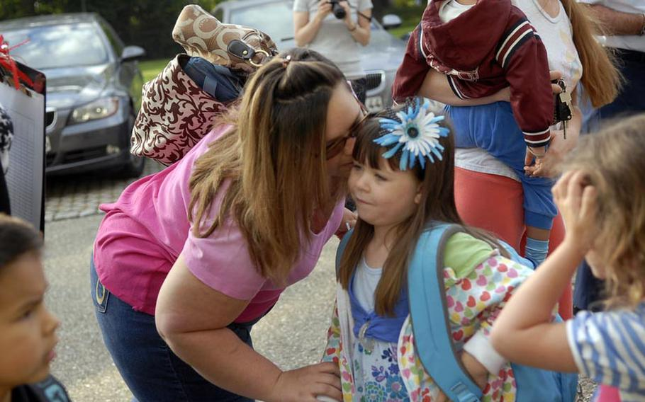 Chassity Beisner gives a farewell-kiss to her daughter, Alyssa Beisner, a first-grader at Robinson Elementary/Middle School, on the first day of school Aug. 29 at Robinson Barracks in Stuttgart, Germany.