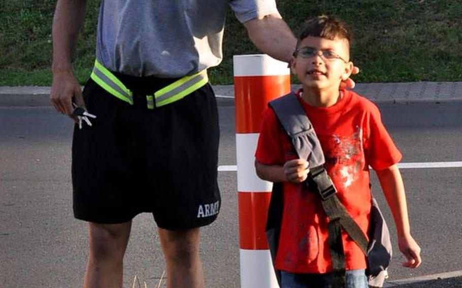 Staff Sgt. Malquer Manzueta says goodbye to his 8-year-old son Miguel, as he heads off to his first day of school at Smith Elementary on U.S. Army Garrison Baumholder in Germany. Manzueta, of Headquarters and Headquarters Battery 1-84 Field Artillery, said his son was starting the 3rd grade.