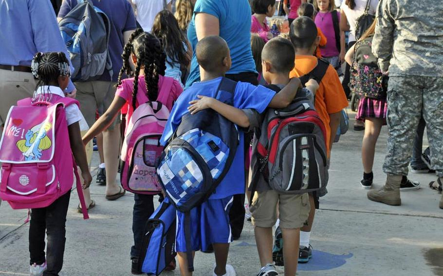 Two buddies make their way to class Monday in Naples, Italy. Students at Defense Department schools around the world head back to class this week.