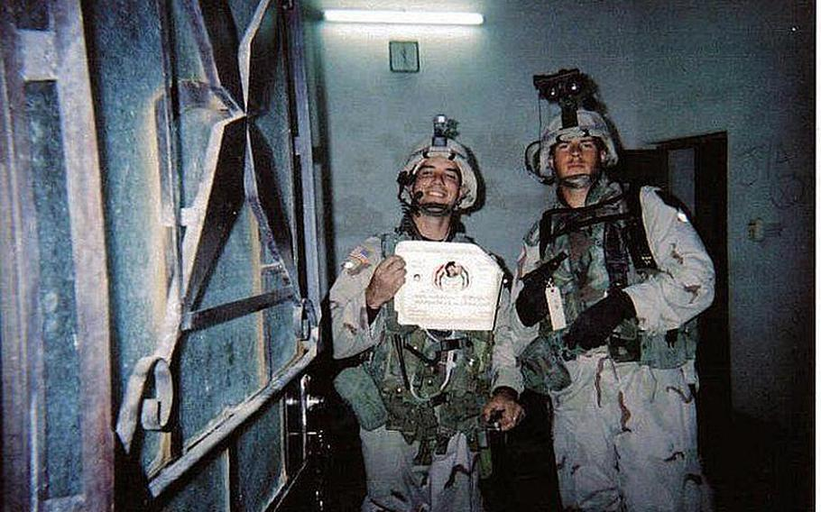 Jamey Raines, then an Army sergeant, and his fellow soldier, Shane Rawson, then a specialist, hold a certificate and pistol they seized after capturing a former general who had served in Saddam's army in 2004. Raines says using marijuana helped him to keep his post-traumatic stress disorder under control while he attended college on the GI Bill.