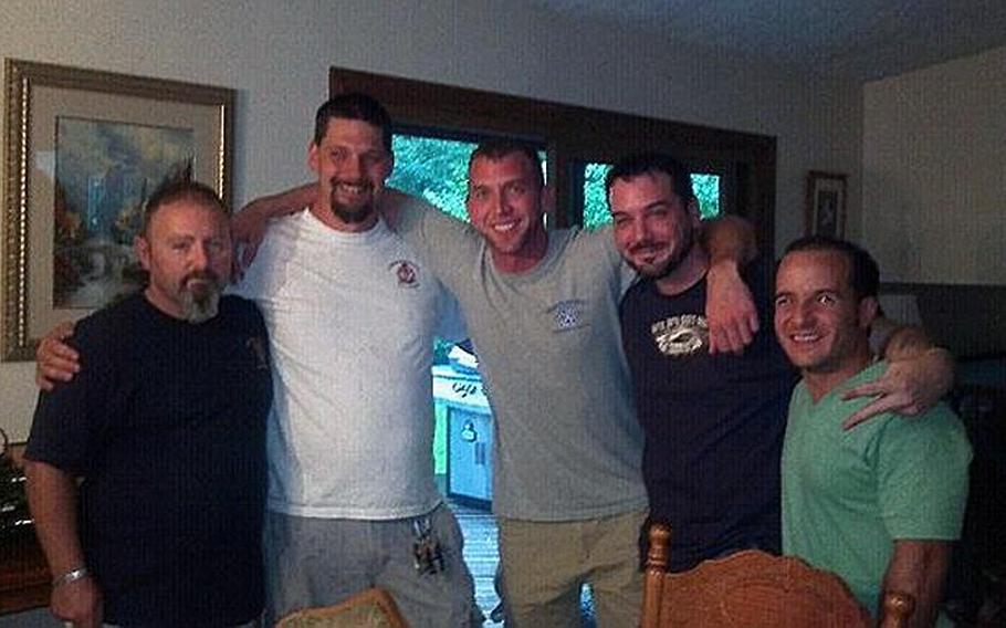 Former Army infantry platoon sergeant Jamey Raines, second from right, at a reunion earlier this month with soldiers from his platoon in Michigan. Raines says using marijuana helped him to keep his post-traumatic stress disorder under control while he attended college on the GI Bill.