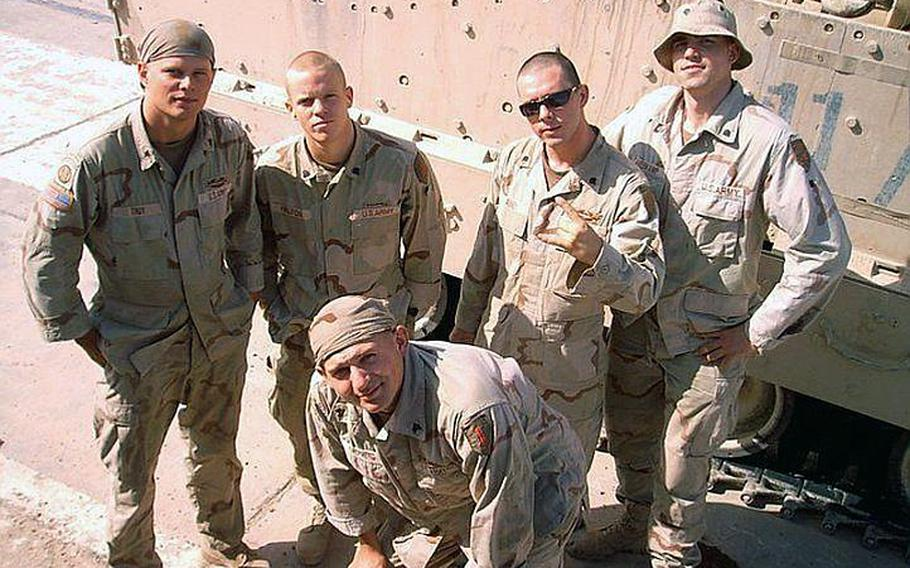 24p cs Sgt. Daniel M. Shepherd, center, who was killed in action in Iraq on Aug. 15, 2004, days before his unit was scheduled to return home, stands with fellow soldiers during their deployment. Seven years later, Shepherd???s death still haunts his friend and fellow soldier, Jamey Raines.