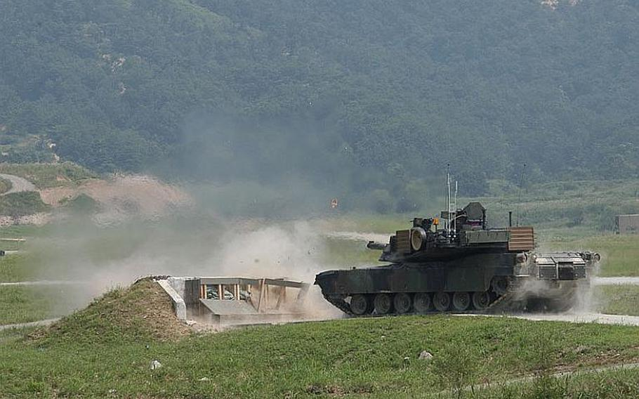 An M1A2 SEP Abrams Main Battle Tank, one of dozens brought by the U.S. military to South Korea, fires a blast during an exercise Sept. 1, 2011, 15 miles south of the Demilitarized Zone.