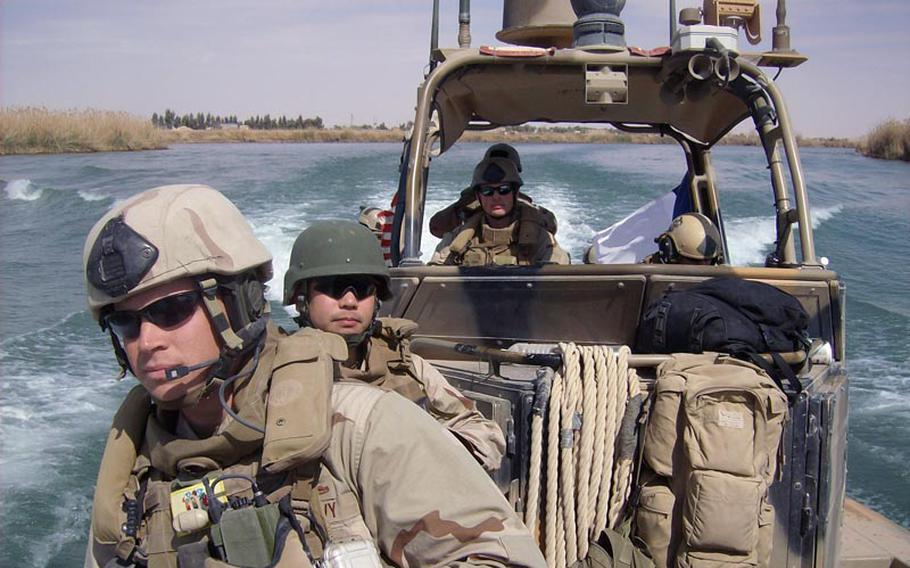 61p bs Photo6 Courtesy of Kyle Staples Navy corpsman Kyle Staples and Marines from his riverine squadron patrol waterways outside Baghdad, Iraq.