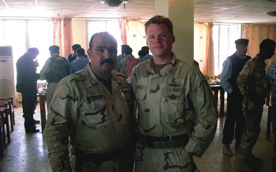 61p bs Photo8 Courtesy of Kyle Staples Navy corpsman Kyle Staples poses alongside an Iraqi soldier during a February 2009 mission.