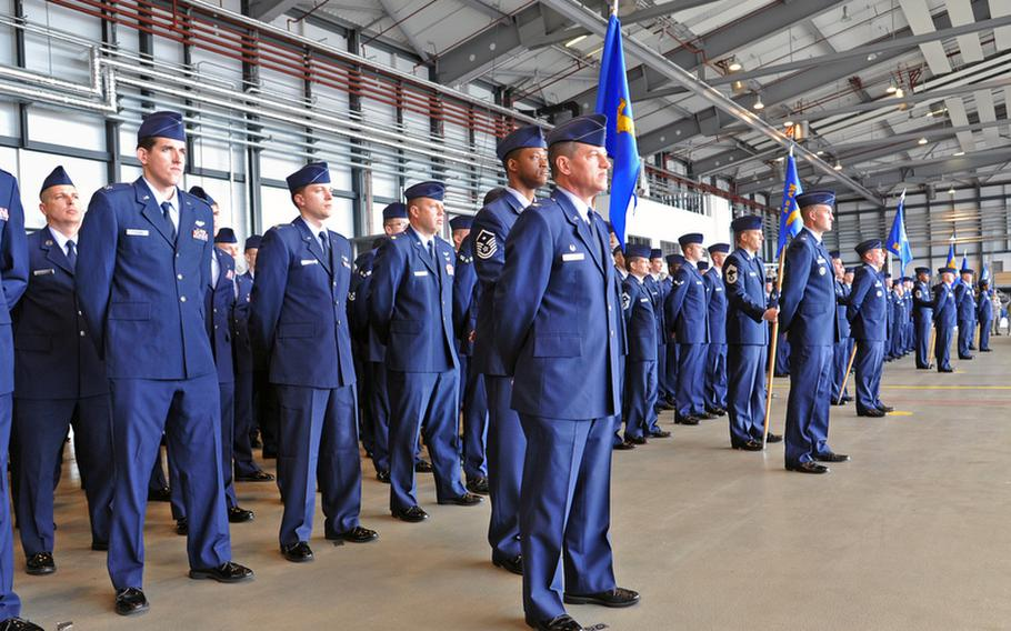 Airmen of the 86th Airlift Wing await the arrival of the official party prior to the wing's change of command ceremony at Ramstein Air Base, Germany, on Friday. Brig. Gen. Charles Hyde took command of the wing, USAFE's largest, from Brig. Gen. Mark Dillon.