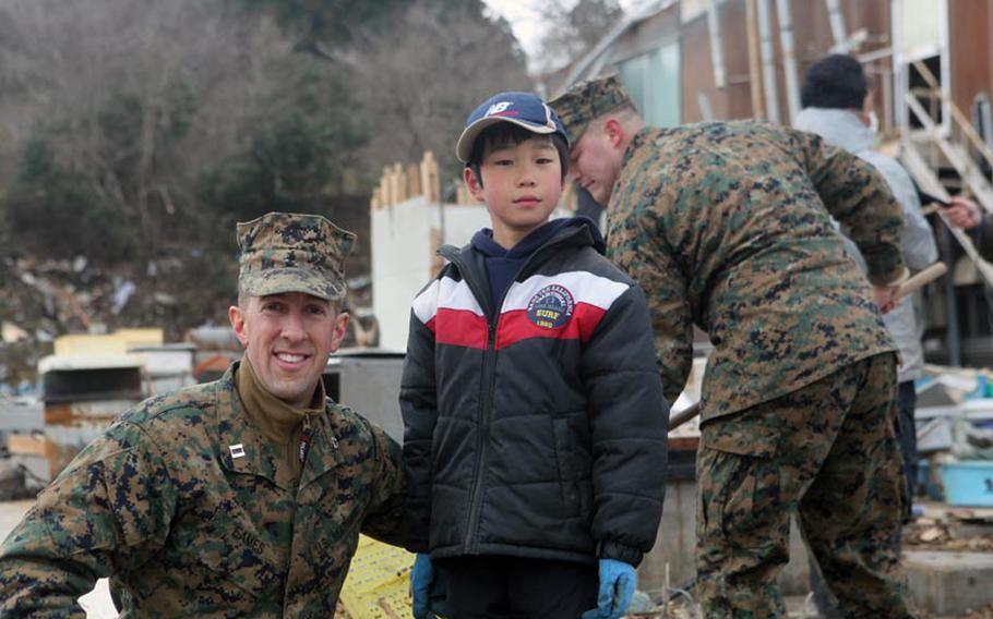 Marine Capt. Caleb Eames,  from Okinawa's 31st Marine Expeditionary Unit, was reminded of his work at Ground Zero when he saw Ikuta Yataru, 8, digging through the dirt on Oshima Island after a tsunami hit Japan.