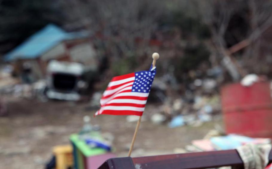 61p bs Courtesy of Caleb Eames   An American flag tucked into the rubble in Japan. Eames recalls seeing a similar ray of hope amid the crumbling towers at Ground Zero right after the Sept. 11, 2001, attacks.