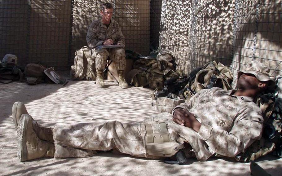 Marine Corps Staff Sgt. Kris Battles sketches at a base near Habbaniyah, Iraq.