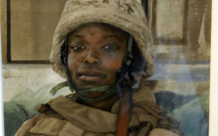 Staff Sgt. Kristopher Battles' 2007 oil painting, ''Portrait of Capt. Elizabeth Okoreeh-Baah of VMM-263, Al Asad, Iraq,'' on display at the National Museum of the Marine Corps in Quantico, Va. Former combat artist Charles Grow, now the museum's deputy director: ''I've heard lots of people say that that's good enough to be a photo, but I would argue that it's better than a photo. Take a look around the edge. There's just a few brush strokes that indicate the environment. There's a tactile, immediate, visceral visual response to this personality. And Staff Sgt. Battles' ability to paint a portrait, especially a quick study like this, is spot on. I've not seen many people better than him.''