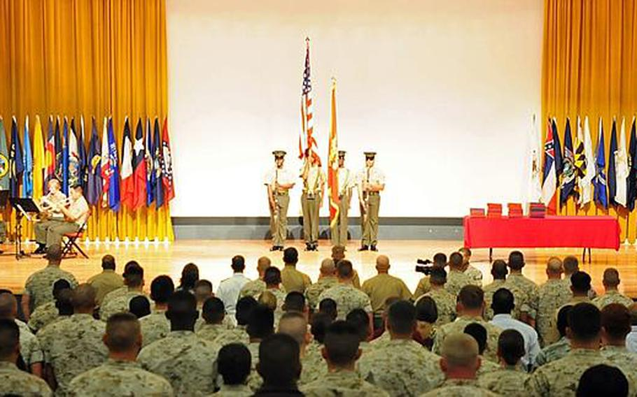 A Marine Corps color guard started things off at the naturalization ceremony at Camp Foster, Friday morning. Sixty-seven service members and spouses became naturalized American citizens during the ceremony.