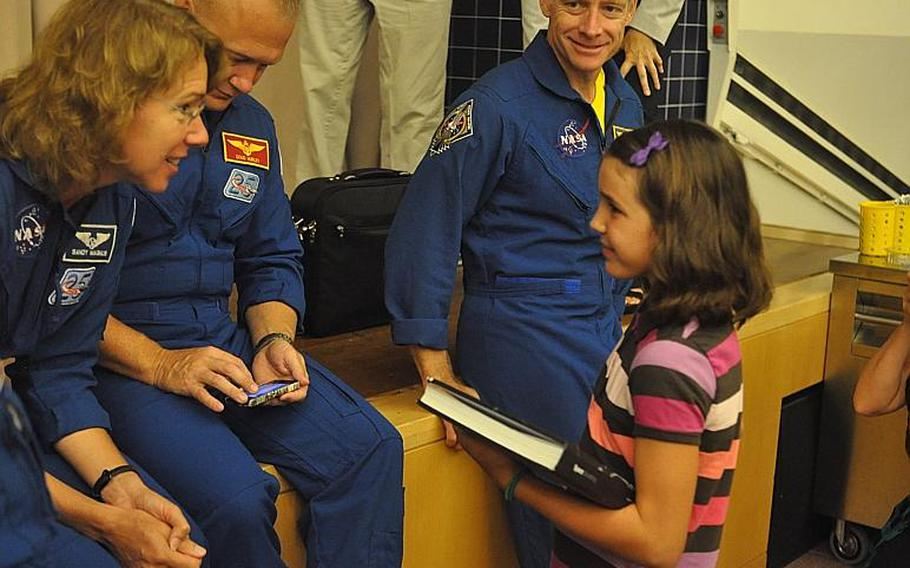 Space Shuttle Atlantis crewmember Sandy Magnus talks with Julia Gabel, a fifth-grader at Aviano Elementary School during the four-member crew's visit to Aviano Air Base on Friday. The astronauts are heading back to the States after visiting U.S. bases in Italy and Turkey the past two weeks.