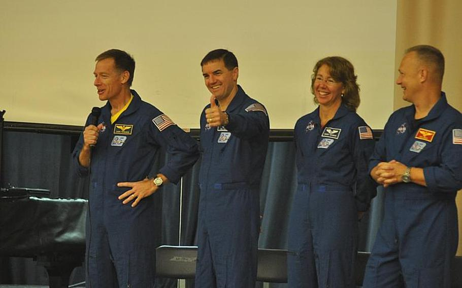 The last crew of the Space Shuttle Atlantis - Chris Ferguson, Rex Walheim, Sandy Magnus and Doug Hurley - laugh at mixed response after Ferguson asked if students at Aviano Elementary School were glad to be back in class after summer vacation.