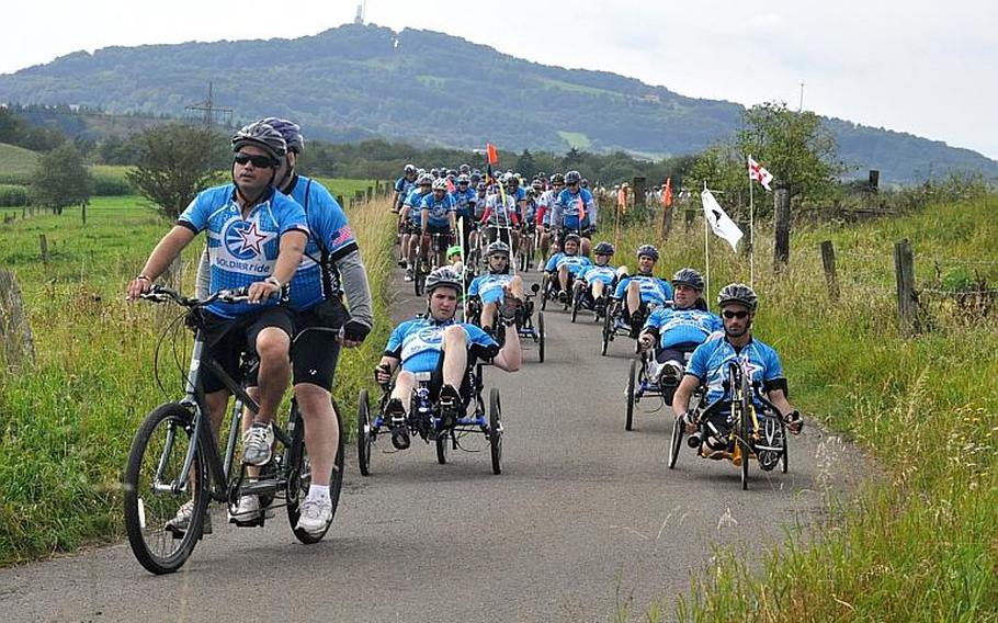 The hills of Saarland, Germany, were no match for more than 60 wounded veterans, who pedaled their way along a 25-kilometer route Sunday as part of the Wounded Warrior Project's Soldier Ride. Joining the veterans were about 250 civilians, who also participated in a barbecue after the ride.