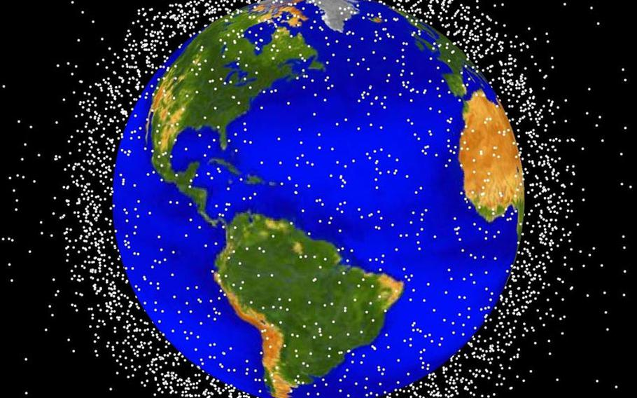The Air Force tracks thousands of objects ? satellites and space junk ? that fill the skies above earth, as shown in this computer-generated image.