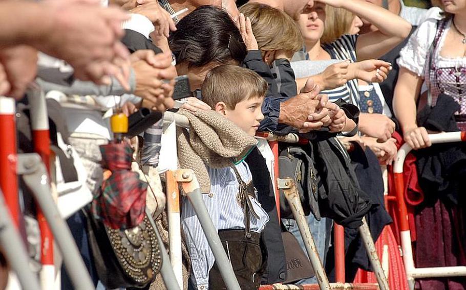 Spectators watch the parade to open Oktoberfest in Munich, on Sept. 17, 2011.