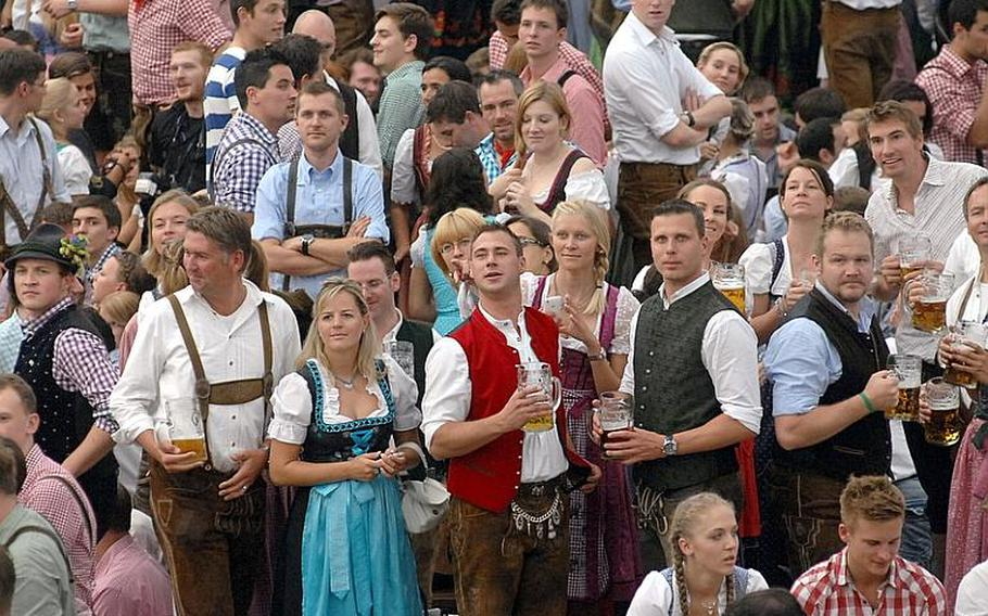 The Oktoberfest tents are full on opening day in Munich on Saturday.