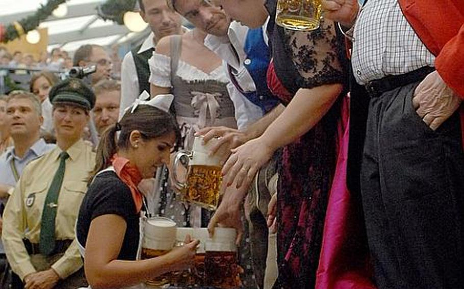 A waitress delivers liter mugs of beer inside the Schottenhamel Festhalle on the opening day of Oktoberfest in Munich Saturday. Organizers expect more than 6 million people to attend the festival, which runs through Oct. 3.
