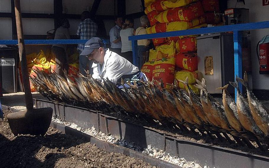 Steckerlfisch -- fish grilled on a stick -- are ready for hungry customers on opening day at Oktoberfest in Munich on Saturday. The festival features a wide array of foods, including chicken, sausages and pork knuckles.