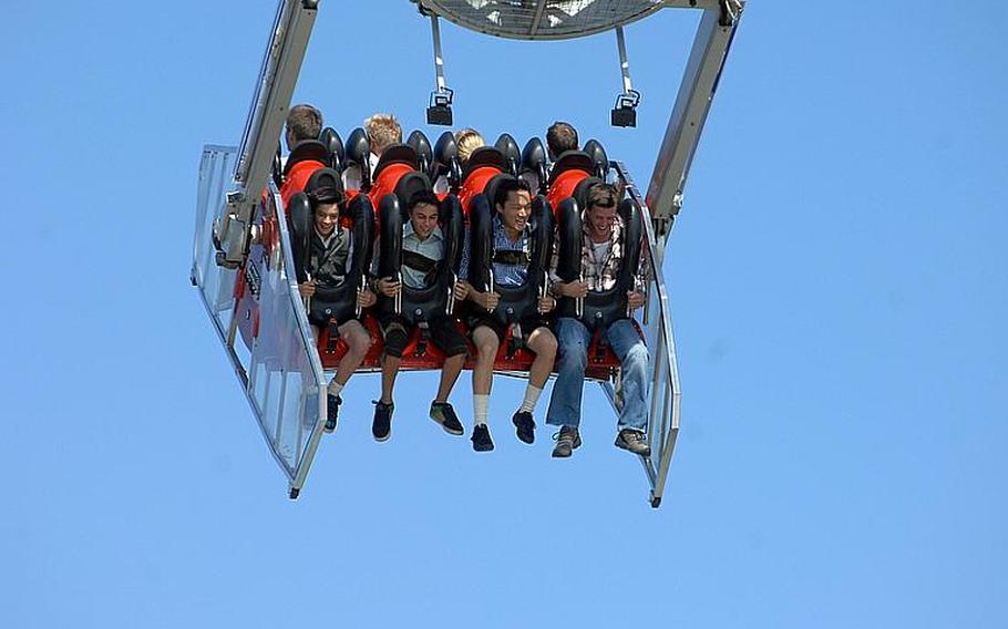 Visitors fly through the air on an amusement ride at Oktoberfest in Munich. In addition to beer, the festival also offers an array of amusement rides.