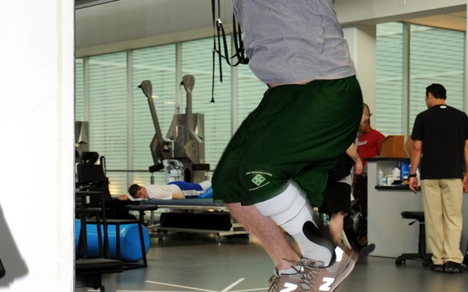"""Spec. Michael Krapels, a member of the Chosen Company, 2nd Battalion, 503rd Infantry Regiment, is able to jump using the Intrepid Dynamic Exoskeletal Orthosis as a part of a physical therapy program called """"Return to Run Clinical Pathway"""" at the Center for the Intrepid at Fort Sam Houston, Texas. Krapels could only walk on flat surfaces before being fitted with the IDEO, and is now preparing to deploy overseas with his unit."""