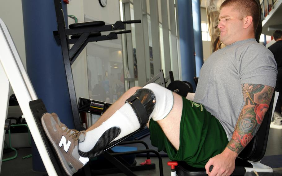 Spc. Michael Krapels, a member of the Chosen Company, 2nd Battalion, 503rd Infantry Regiment, works to strengthen his leg while wearing an Intrepid Dynamic Exoskeletal Orthosis during physical therapy at the Center for the Intrepid at Fort Sam Houston, Texas in August.
