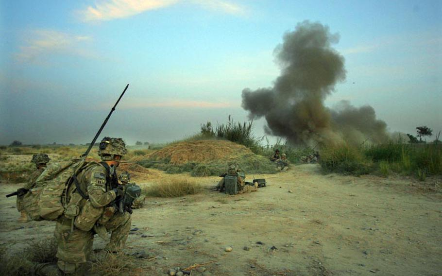 Commander Capt. Dennis Call of Company C, 1st Battalion, 32 Infantry Regiment, 3rd Brigade Combat Team, 10th Mountain Division watches as an anti-personnel obstacle breaching system is blown at dawn during Operation Steel Lion III on August 27, 2011, at Strong Point Alizi in Kandahar Province, Afghanistan.
