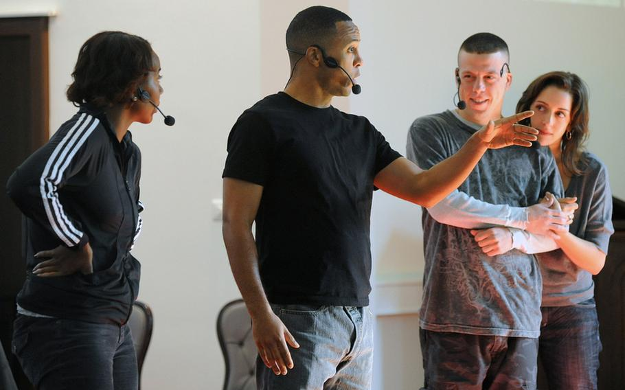 """Sameerah Luqmaan-Harris, Brandon Jones, BenRosenblatt and Jessi Blue Gormezano, from left, perform in """"ReEntry,"""" a play about servicemembers coming home from war. The actors from the American Records theater company played multiple characters in the piece that uses actual interviews with combat veterans and their families as dialogue."""