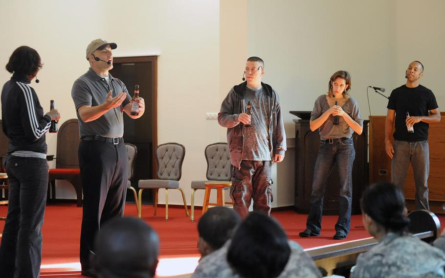 """Sameerah Luqmaan-Harris, Larry Mitchell, Brandon Jones, BenRosenblatt and Jessi Blue Gormezano, from left, play soldiers in a bar talking about how people who have never been to war do not understand them in """"ReEntry.""""  The actors from the American Records theater company took on multiple character roles in the piece that uses actual interviews with combat veterans and their families as the dialogue."""