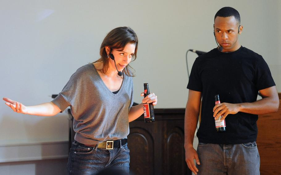 """Jessi Blue Gormezano, left, and Brandon Jones play soldiers in a bar in """"ReEntry"""", a play about servicemembers coming home from war. The actors from the American Records theater company played various roles in  the play, whicih uses interviews with combat veterans and their families as the dialogue."""