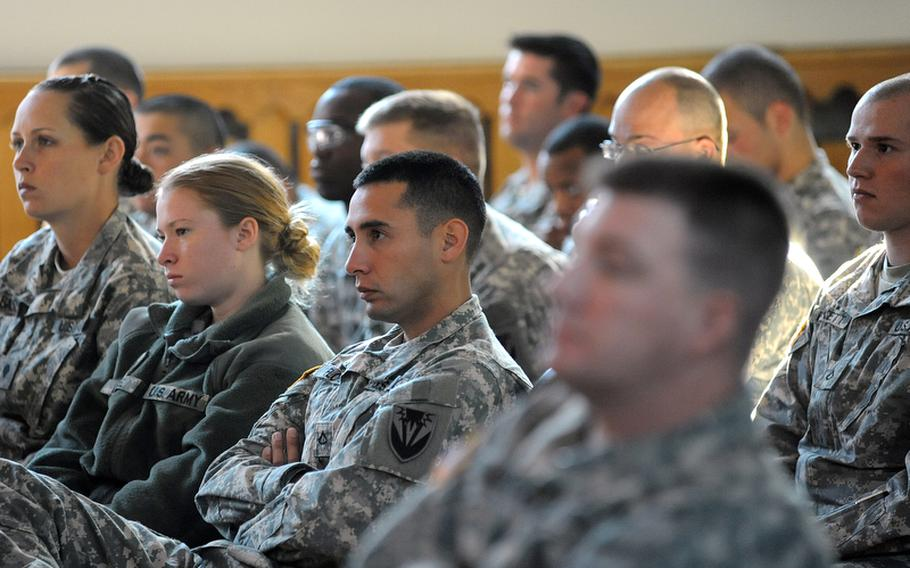 """Kaiserslautern soldiers watch """"ReEntry,"""" a play about servicemembers returning from war, on Wednesday. The American Records theater company troupe is touring bases in Germany and Italy, performing the play that uses actual dialogue from interviews with combat veterans and their families."""